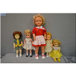 """Selection of vintage dolls including three Reliable magic skin, hard plastic doll and a 16"""" Dee & Ce"""
