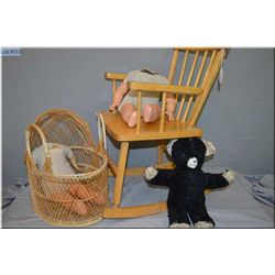 Child's maple rocking chair and woven doll bassinette plus two stuffed doll bodies with composition
