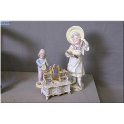 """Two vintage figurines including girl with glasses reading a book 12"""" in height (tiny fleck on hat) a"""
