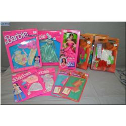 Large selection of new in package Ken and Barbie fashions, plus a vintage new in package PJ doll