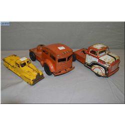 Vintage stamped steel toys including three highway tractors