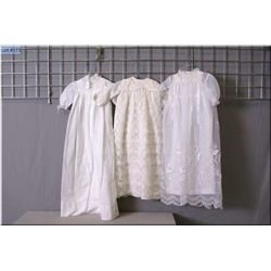 Three vintage christening gowns including white cotton, lace and organdy style with pearl beading