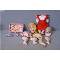 Selection of doll parts including porcelain heads and composition body parts including AM 390