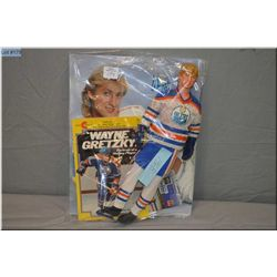 """Vintage Wayne Gretzky """"Oilers"""" doll complete with outfit and skates, a Wayne Gretzky fan club book a"""