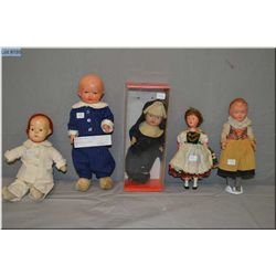 """Selection of vintage composition dolls including 9"""" celluloid doll in regional costume, small compos"""
