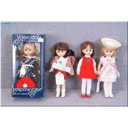 """Four vintage """"Ginny"""" by Vogue 8"""" plastic dolls, all with sleep eyes and original dresses, one new in"""