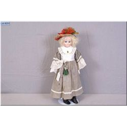 """Antique 16"""" doll with wax over composition head, glass eyes, mohair wig, on stuffed kid leather body"""