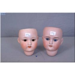 Two antique bisque doll heads including AM 390 with sleep eyes and repair to neck and a Nippon doll
