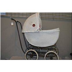 Vintage white wicker doll buggy with lovely pink upholstered interior