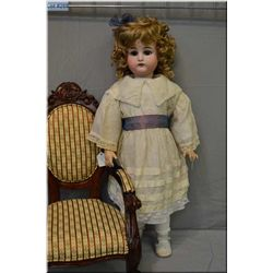 """Large and beautiful 29"""" Kammer and Rheinhardt bisque head doll on composition body with set brown gl"""