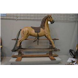 """Vintage 34"""" gliding rocking horse with glass eyes, tooled leather saddle and hand painted detailing"""