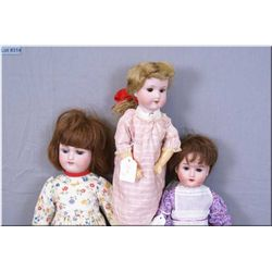 """Three antique bisque head dolls including 15"""" Armand Marseille 390 with sleep eyes, open mouth, no c"""