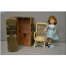"""14"""" hard plastic doll with open mouth, sleep eyes and saran hair in original outfit, a woven wicker"""