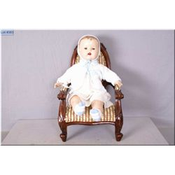 """20"""" baby doll with composition head, arms and legs on stuffed body, sleep eyes, molded hair and open"""
