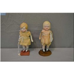 """A pair of 7"""" Nippon all-bisque dolls with painted eyes, shoes and socks and hand made antique dresse"""