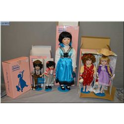 """Four new in box sets of Marian Yu Design dolls including two sets of 11"""" hand painted boy and girl w"""
