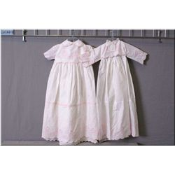 Two vintage white cotton baby Christening dresses with pink teddy bears on parade embroidered detail