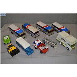 Two tray lots of vintage cars and trains including Buddy L Greyhound buses, Tonka RC, assorted rescu