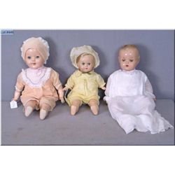 """Three vintage composition dolls including a 17"""" Reliable Baby Lovums doll with composition head, arm"""