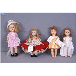 "Four vintage hard plastic dolls including 8"" Madame Alexander in all original Swiss costume, an 8"" """