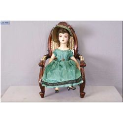 1920's Boudoir doll with composition head, arms and high heeled legs on stuffed body. Good compositi