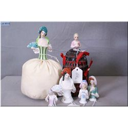 Six vintage glazed porcelain pin cushion dolls