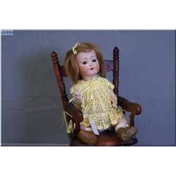"13"" Heubach Kopplesdorf 320. 7/0 bisque head doll with sleep eyes, open mouth, human hair wig on a b"
