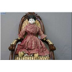 "21"" china head doll with molded black hair, all original, minor paint loss to hair. Auction estimate"