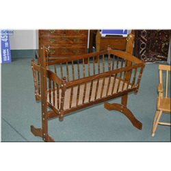 Rocking cradle suitable for doll display