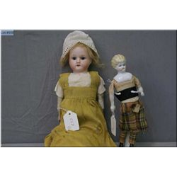 "Two antique bisque head dolls including 16"" ""Mabel"" on 11/0 shoulder head on kid leather body with b"