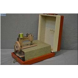 Child's vintage Singer Sewing machine model 40 in original hard carrying case, complete with clamp,