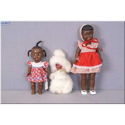 Three vintage dolls including hard plastic Topsy, Reliable hard plastic in fur costume and a rubber