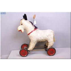 Child's vintage stuffed donkey riding toy