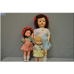 "Three vintage hard plastic dolls including English Pedigree 21"" Walking doll circa 1950, plus a 13"""