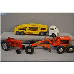 Hubley farm tractor, Structo grader, and Structo car carrier
