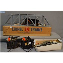 Selection of Lionel train accessories including two Type 1033 transformers, #317 trestle bridge and
