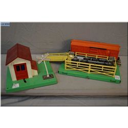Two Lionel train accessories including #3656 stock car outfit and a crossing guard