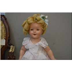 """18"""" Ideal Shirley Temple composition doll in excellent condition with original onesie and tagged dre"""
