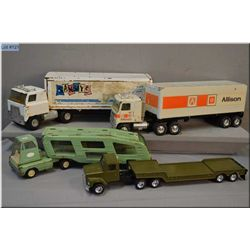 Selection of highway trucks including car carrier, flat deck and two cargo haulers