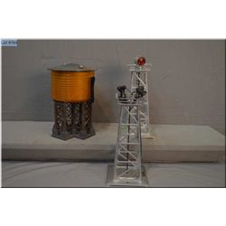Three Lionel train accessories including #395 floodlight tower, #394 beacon, #30 water tower