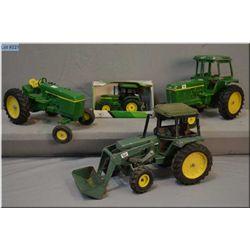 Selection of John Deere tractors including one Ertl in box