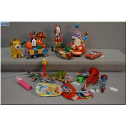 Selection of tin plate including vintage and reproduction, spinner, noise makers, cars etc.