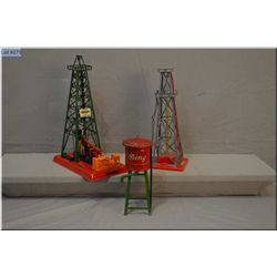 Selection of train accessories including Lionel #455 oil derek and pumper, Colber rig, and German ma