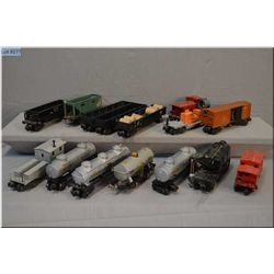 Selection of Lionel rolling stock including tankers, cabooses, #2460 crane, mechanical cargo car, #2