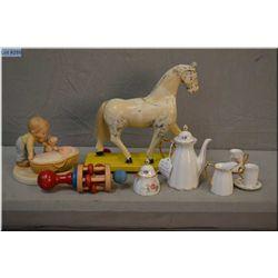 Wooden rattle, tea set, wooden horse pull toy etc.