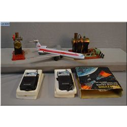 Toys including two stationary steam engines, a TWA Boeing 727 and a pair of boxed Walkie talkies