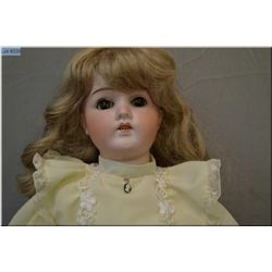 """24"""" Curnen and Steiner (?) bisque head doll on composition body, with sleep eyes, missing one lash,"""