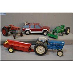 Selection of toys including an Ertl front end loader, Ford 4000 etc.