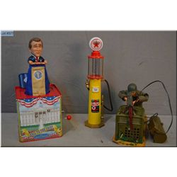 George W. Bush Jack-in-box toys that plays Hail to the Chief, a US Army machine gunner and a vintage