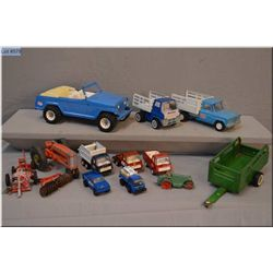 Selection of vintage Tonka including Jeeps, dump truck, grain truck etc. plus a dinky steam roller a